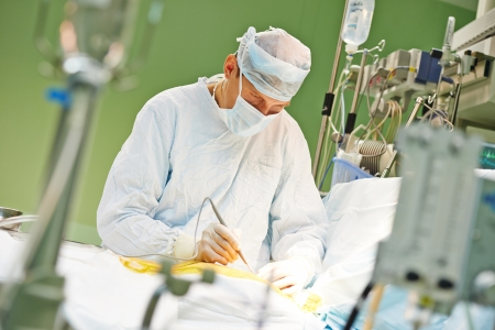 cardiac surgery: surgeon perform operation on a patient at heart surgery clinic