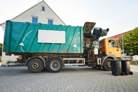 recycling garbage collector truck loading waste and trash bin photo