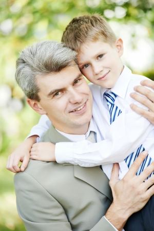 Portrait of young happy father business with son boy outdoors photo
