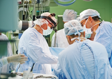 Team of surgeon in uniform perform operation on a patient at cardiac surgery clinic Stock Photo - 22086509