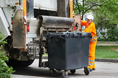 urban municipal recycling garbage collector truck loading waste and trash bin photo