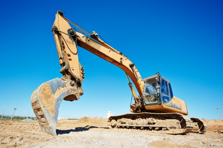 sand quarry: loader excavator machine doing earthmoving work at sand quarry