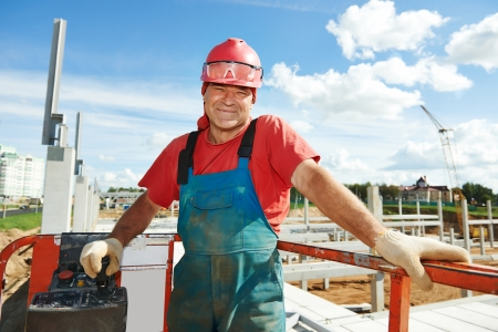 Portrait of builder worker in lift machine at metal construction framework installation Stock Photo - 22224301
