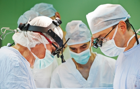 Team of surgeon in uniform perform operation on a patient at cardiac surgery clinic Stock Photo - 22224307