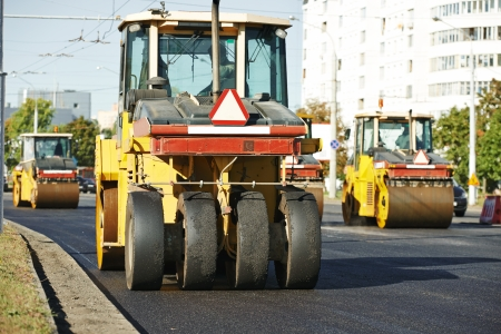 multilayered: Pneumatic tyred roller compactor at asphalt pavement works for road repairing