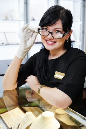 Portrait of smiling female sales assistant in jewelry shop photo