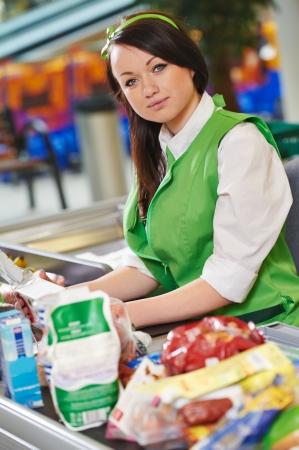saleswomen: Portrait of Sales assistant or cashdesk worker in supermarket store Stock Photo