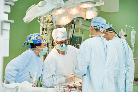Team of surgeon in uniform perform operation on a patient at cardiac surgery clinic Stock Photo - 22844793