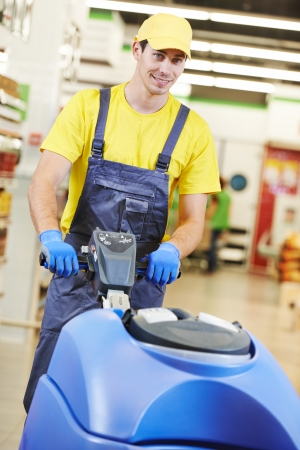 cleaning: Floor care and cleaning services with washing machine in supermarket shop store