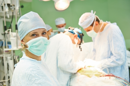 Portrait of nurse at surgeon in uniform perform operation on a patient at cardiac surgery clinic Stock Photo - 22801586