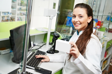 pharmacist chemist woman working in pharmacy drugstore with tablet computer photo