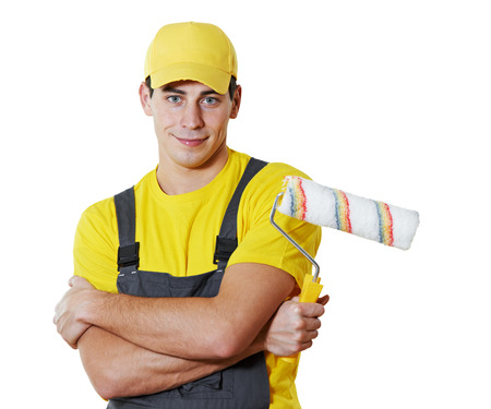 priming: painter man worker portrait with painting roller