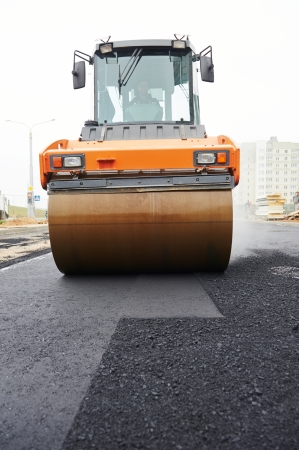 construction vibroroller: Heavy cibration roller compactor at asphalt pavement works for road repairing Stock Photo