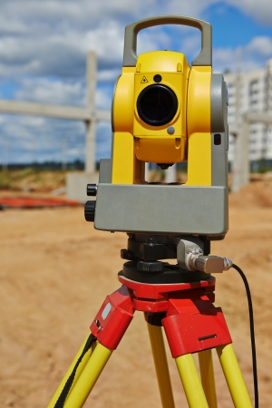 Surveyor equipment theodolite outdoors at construction site photo