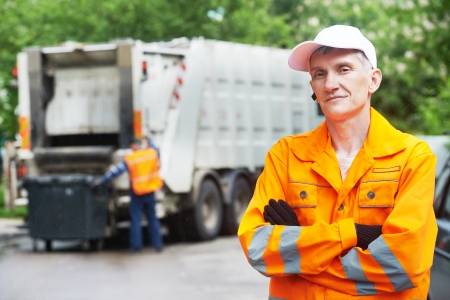 garbage disposal: Portrait of municipal worker recycling garbage collector truck loading waste and trash bin