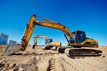 sand quarry: Two track-type loader excavator machine at earthmoving work in sand quarry