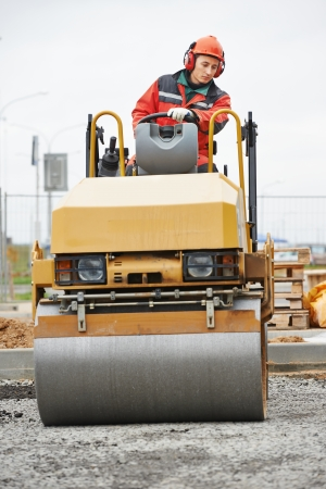Light vibration roller compactor at urban road construction and repairing asphalt pavement works photo