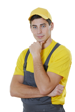 young man worker portrait with painting roller photo