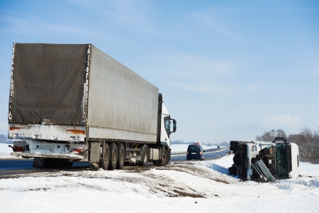collision: Lorry trailer car crash smash accident on an slippery winter snow interstate road Stock Photo