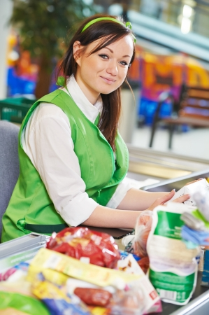 supermarket cash: Portrait of Sales assistant or cashdesk worker in supermarket store Stock Photo