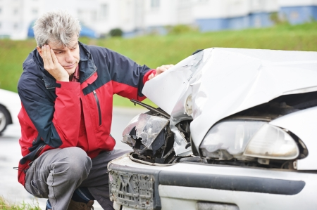 car body: Adult upset driver man inspecting automobile body after crash car collision accident