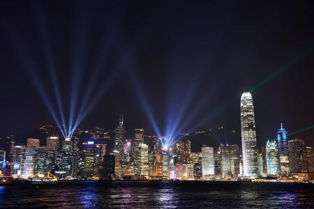 highriser: night view at the Hong Kong island with reflections at victoria harbor