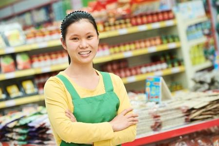 sellers: chinese young woman choosing food tea during shopping at china supermarket Stock Photo