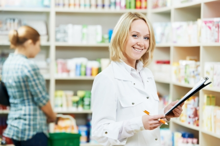 pharmacist chemist woman working in pharmacy drugstore photo