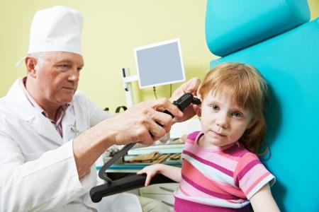 Medical otolaryngologist ear nose throat doctor examining little girl Stock Photo - 24300270