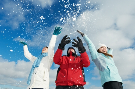 snowbank: Young people having fun with snow in winter outdoors