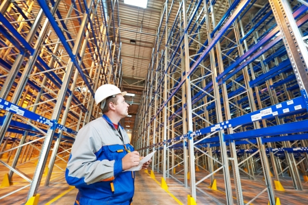 engeneer: two warehouse worker in front of rack stack in storehouse
