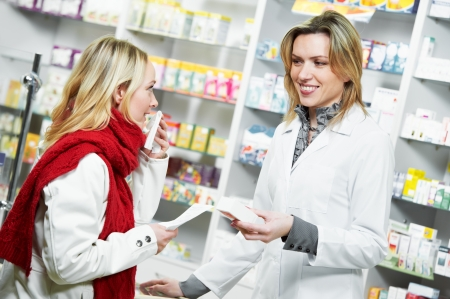 medication: pharmacist suggesting medical drug to buyer in pharmacy drugstore