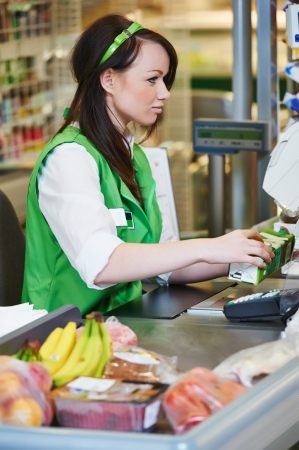 purchaser: Portrait of Sales assistant or cashdesk worker in supermarket store Stock Photo