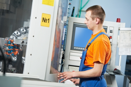 manufacture technician worker near cnc milling machine center at tool workshop Stock Photo - 24711682