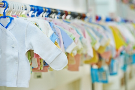 newborn clothes at baby shop store