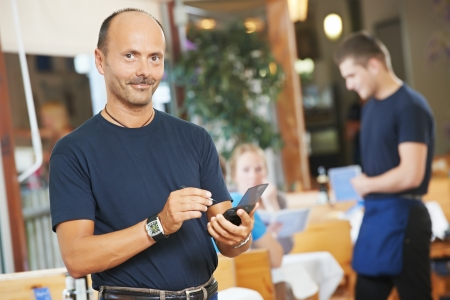 waiter ready to serving or order in small italian restaurant photo