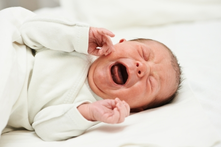 child crying: newborm baby screaming just after born Stock Photo