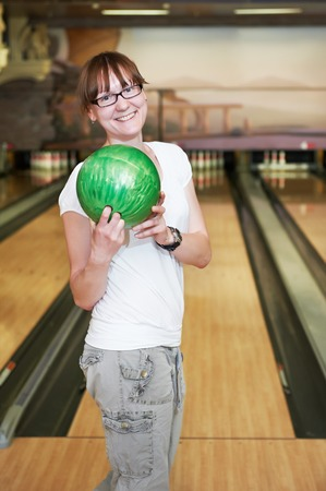 Cheerful young adult woman bowling player photo