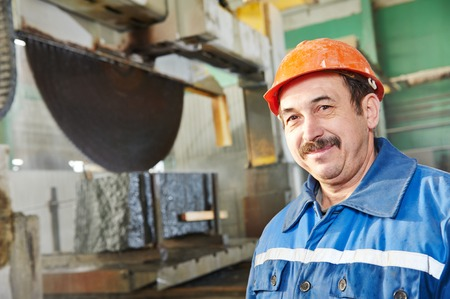 engeneer: industrial worker at factory on granite or marble manufacturу Stock Photo