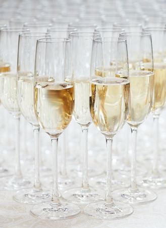 pyramid of champagne glasses during catering at party photo