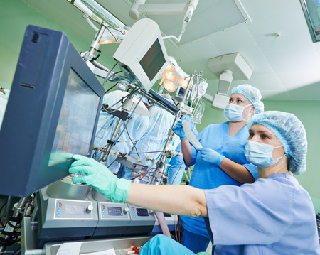cardiosurgery: Surgery assistant nurse working with artificial cardiac valve at operation in cardiology clinic