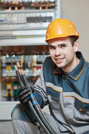 erector: Happy young adult electrician builder engineer portrait