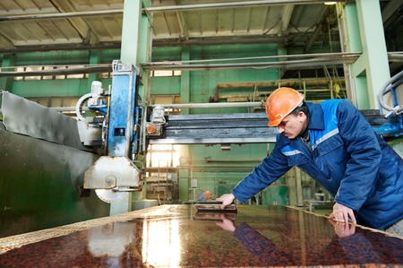 granite: industrial worker at factory on granite or marble manufacturу Stock Photo