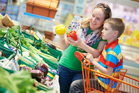 woman and child boy during family shopping with trolley at supermarket Stock Photo - 27914296