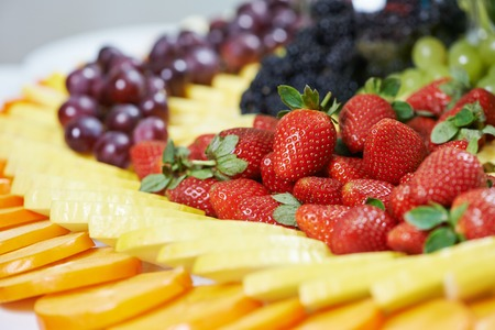 catering service: catering services background with fruits and berry in restaurant Stock Photo