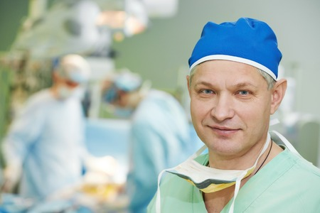 cardiosurgery: Male surgeon in uniform in front of cardiac surgery operation room at clinic