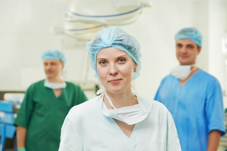cardiosurgery: Team of surgeon in uniform after surgery operation at clinic operating room Stock Photo
