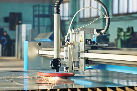 laser cutting: Industrial laser or plasma cutting processing manufacture technology of flat sheet metal steel material with sparks Stock Photo