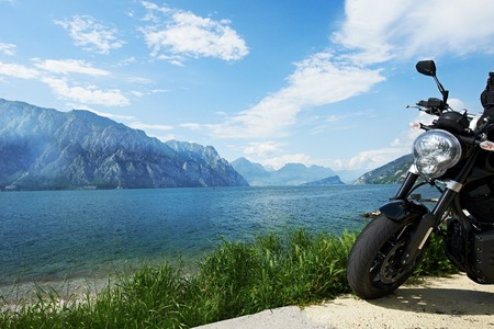 garda: lake Garda in Italy. Motorbike standing on shore Stock Photo