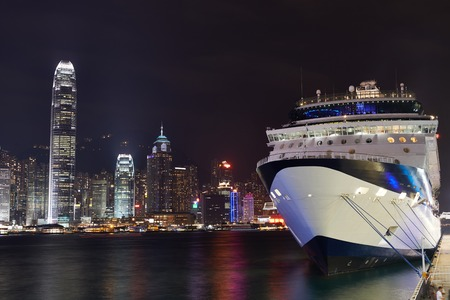night view at the Hong Kong harbour with liner ship with reflections at victoria harbor